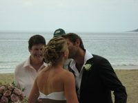 Hannah and Lee kiss in front of the wedding celebrant.