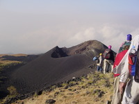 Cinder cone with group walking towards it