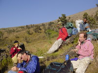 Part of the group sitting, resting and applying factor 25 on the mountainside