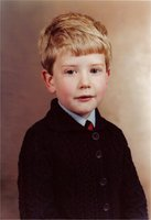 A young me in a cardigan and tie