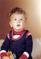 A young me with untidy hair and a fetching blue and red outfit
