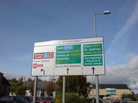 A directional sign at the Craigs roundabout.