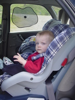 Joseph strapped into a car seat in the back of a Citroen Xsasa Picasso