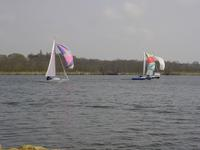 Picture of yachts with brightly coloured sails on Wroxham Broad