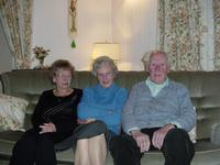 Picture of my Great Aunt Daphne, Granny and Grandpa sitting in my Grandparents' living room on Boxing Day