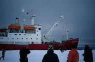 Winterers watching the ship leave
