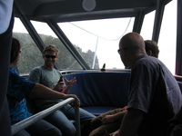Inside a small boat, a group of people.