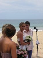 Hannah, in her bridal gown, looks over her shoulder toward her bridesmaids.