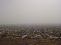 View across a city, visibility reduced by dust in the air