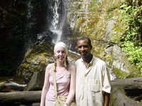Eleanor standing with Laide in front of a small waterfall
