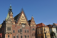 A elaborately decorated old building with towers, spires and a clock.
