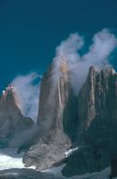 Picture of the Torres del Paine (Chile) with a column of cloud up the side of one of the towers