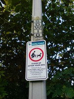 'Clean up after your dog' sign and lamppost ID tag.