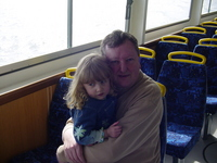 Dad holding Eve inside the cabin of a ferry